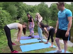Girls with an increment of a boy do yoga open-air